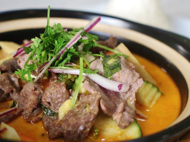 96. Thai curry beef cooked in a clay pot